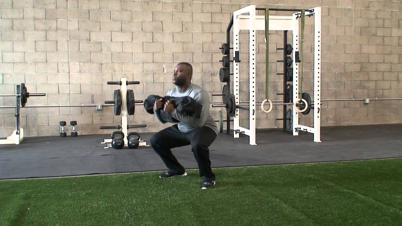 Brute Force Sandbags Workout Zercher Squat Exercise